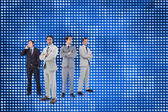 Businessmen standing arms crossed. Composite image of attractive businessmen standing arms crossed Royalty Free Stock Image