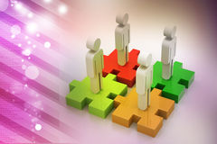 Businessmen are standing on different colored puzzle pieces. In color background Royalty Free Stock Photo