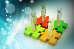 Businessmen are standing on different colored puzzle pieces. In color background Royalty Free Stock Photography