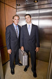 Businessmen standing in elevator Royalty Free Stock Photography