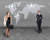 Businessmen standing in front of an earth map. Elements of this image furnished by NASA Stock Image