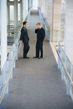 Businessmen Standing In Office Hallway Royalty Free Stock Photo
