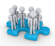 Businessmen standing on puzzle piece. A group of businessmen are standing on a puzzle piece Royalty Free Stock Photography