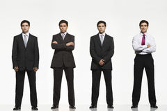 Businessmen Standing Side By Side. Full length portrait of businessmen standing side by side against white background Royalty Free Stock Photography