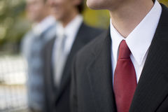 Businessmen standing together stock photo