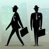 Businessmen on the street. Couple of businessmen on the street - one stands, one walks Royalty Free Stock Photo