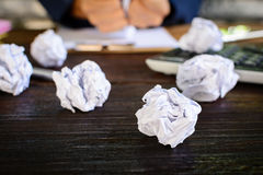 Businessmen stress and Fear Crushed paper on wood table Stock Photo