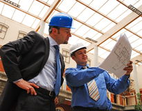 Businessmen Studying Blueprint Royalty Free Stock Photos