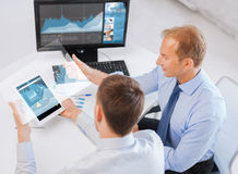Businessmen with tablet pc and computer at office Stock Photography