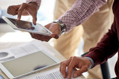 Businessmen with tablet pc and papers at office Royalty Free Stock Photo