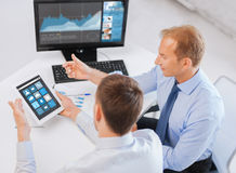 Businessmen tablet pc using applications at office Royalty Free Stock Image