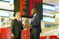 Businessmen talking airport Stock Photos