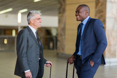 Businessmen talking airport Stock Photography