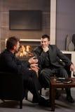 Businessmen talking in bar Royalty Free Stock Photo