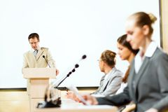 Businessmen talking at the conference Stock Image