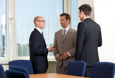 Businessmen talking in conference room Royalty Free Stock Photo