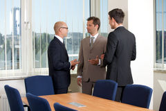 Businessmen talking in conference room Stock Image
