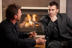 Businessmen talking at home Stock Images