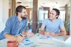 Businessmen talking Stock Images