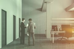 White industrial office with doors, people royalty free stock image