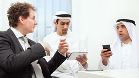Businessmen talking on a meeting Stock Photography