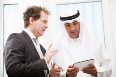 Businessmen talking on a meeting Stock Photos