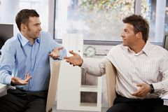 Businessmen talking in office Royalty Free Stock Photography