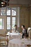 Businessmen Talking At Restaurant Table Stock Photos