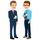 Businessmen Talking Standing. Two businessmen standing talking and chatting on break time Stock Image