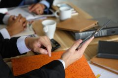 Businessmen team discuss project using tablet. Businessmen team discuss project by using digital tablet in meeting room of coffee cafe. Business meeting with stock photo