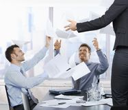 Businessmen throwing documents up Royalty Free Stock Images