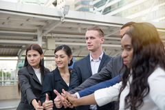 Businessmen thumb up to celebrate achievement stock photography