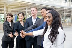 Businessmen thumb up to celebrate achievement Royalty Free Stock Images
