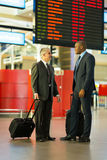 Businessmen travelling together Royalty Free Stock Images