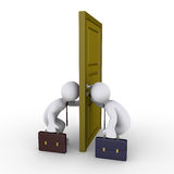 Businessmen trying to find success keyhole. Two businessmen looking through keyhole on opposite sides of door Royalty Free Stock Images