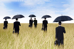 Businessmen with umbrella outdoor Royalty Free Stock Photo
