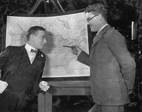 Businessmen with US map. (All persons depicted are no longer living and no estate exists. Supplier grants that there will be no model release issues Stock Photography