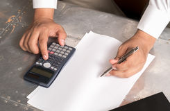 Businessmen use the calculator Stock Photography