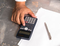 Businessmen use the calculator Royalty Free Stock Image