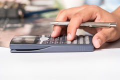 Businessmen use the calculator Stock Photos