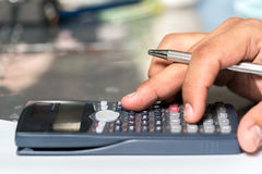Businessmen use the calculator Royalty Free Stock Photo