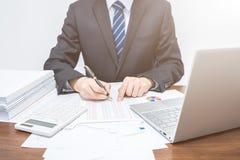 Businessmen using computer accounting data stock image