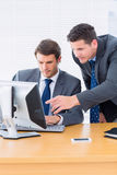 Businessmen using computer at office desk Royalty Free Stock Images