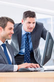 Businessmen using computer at office desk Royalty Free Stock Image