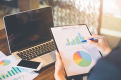 Businessmen are using a computer to analysis charts and graphs r royalty free stock photo