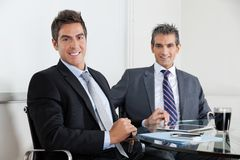 Businessmen Using Digital Tablet In Office Stock Photography