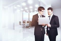 Businessmen using laptop Stock Photo