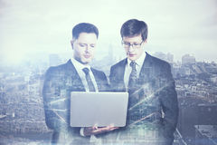 Businessmen using laptop multiexposure Royalty Free Stock Images