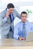 Businessmen using laptop Stock Image