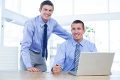 Businessmen using laptop Royalty Free Stock Images